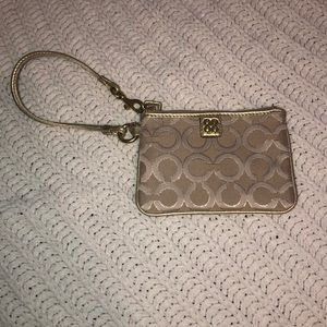 Gold Coach Wristlet Clutch